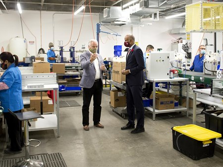 On Oct 30, 2020, the Honorable Ahmed Hussen (MP York South-Weston) toured dynaCERT's Toronto assembly plant and learned about HydraGEN™ Technology from DYA COO & Chief Engineer Robert Maier 21272 on oct 30 2020 the honorable ahmed hussen (mp york 3